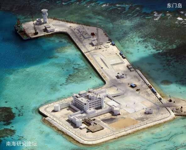 南沙群岛最新填海囹�a_2014年我国在南薰礁上吹沙填海而来的人工岛,可以坚实地拱卫南沙群岛