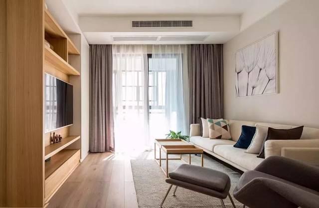 客厅 ▲客厅,木纹材质的电视墙柜在自然柔和的原木肌理内,凸显出朴实