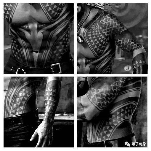 海王的纹身造型就是一身战甲,元素上是鳞片和鲨鱼牙齿为主,值得注意