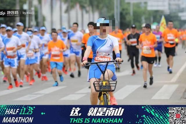 女跑友赛道中多次骑单车,徐州马拉松火速开罚单图片