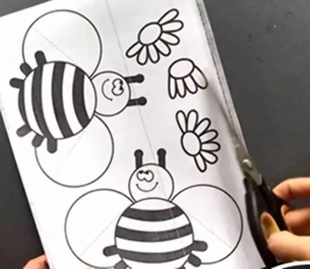 将小蜜蜂沿边缘线剪下.图片