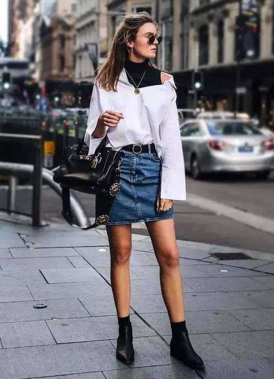 粗跟短靴搭配裙子虽然少一分妩媚,但多一分稳重和率性.图片