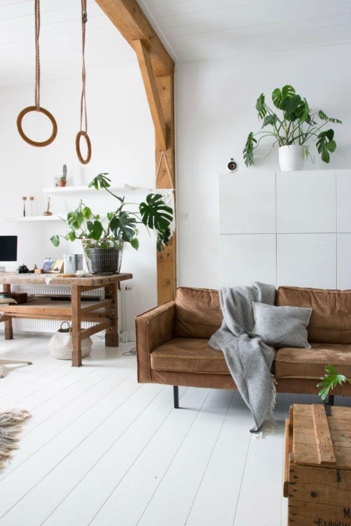 白色的室内装饰与工业风格宁静柔和的气氛贯穿整个空间