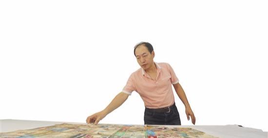 小人书里的大世界泉州刻画家吕照明28年收藏连环画近万本