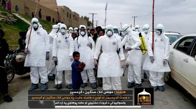 塔利班防疫:一手 AK